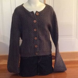Sweaters - Long sleeved cardigan. Button up front.